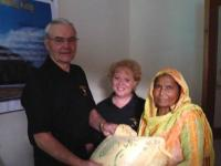 Distributing rice to the widows!
