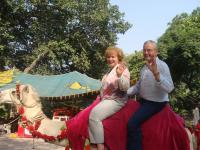 Pakistan transportation for Pastor Leo Strathman and Donna on a camel.