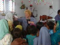 Donna teaching and ministering at the Children's service in Pakistan